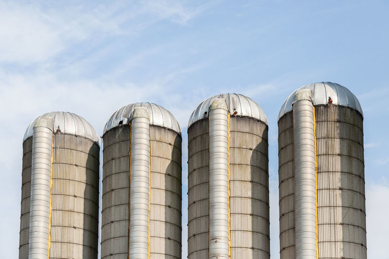 Be Brave Farm Agriculture Architecture Building Exterior Built Structure Business Cylinder Day Factory Farming Food And Drink Food And Drink Industry Food Processing Plant In A Row Industry Low Angle View Nature No People Outdoors Side By Side Silo Silver Colored Sky Storage Tank