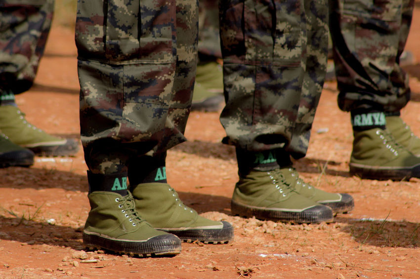 Unidentified A Soldier at Shan State in Myanmar Armed Forces Army Army Soldier Body Part Boot Camouflage Clothing Clothing Day Government Group Of People Human Body Part Human Leg Human Limb Low Section Marching Military Military Uniform Outdoors People Real People Shoe Standing Uniform