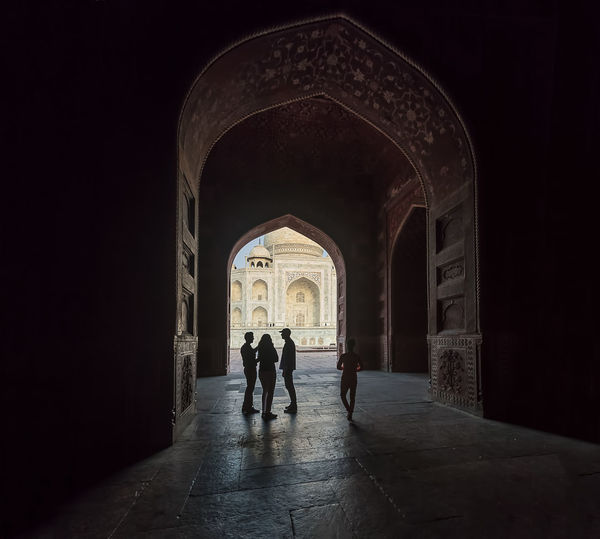 Silhouettes in front of the Taj Mahal India Shrine Taj Mahal Tourists Adult Agra Arch Architecture Building Built Structure Day Full Length Group Of People History Holy Indoors  Lifestyles Men People Real People Rear View The Past The Way Forward Tourism Travel Destinations