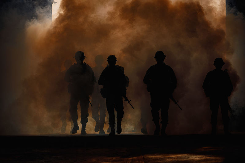 Teamwork Fire - Natural Phenomenon Fog Full Length Group Of People Men Motion Nature Night People Real People Rear View Silhouette Smoke - Physical Structure Soldiers Uniform Standing Walking War