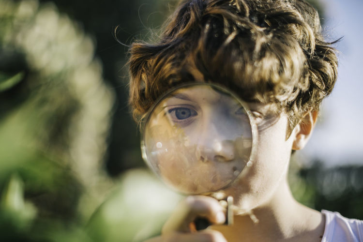 Big Eyes Blond Hair Boys Childhood Close-up Day Elementary Age Headshot Magnifying Glass Magnifying Lens One Person Outdoors People Real People Selective Focus Young Adult