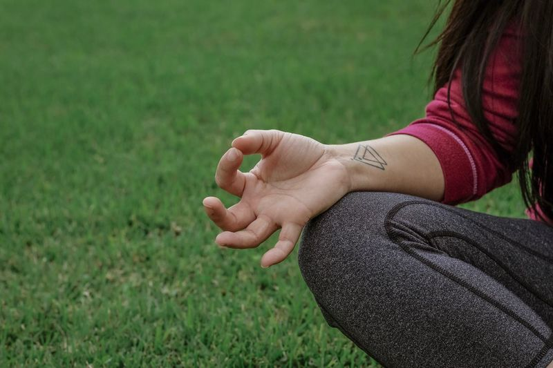 Tattoo Peaceful Meditation Resolution Yoga Pose Yoga One Person Human Hand Hand Real People Grass Field Land Lifestyles Leisure Activity Outdoors The Modern Professional Moments Of Happiness