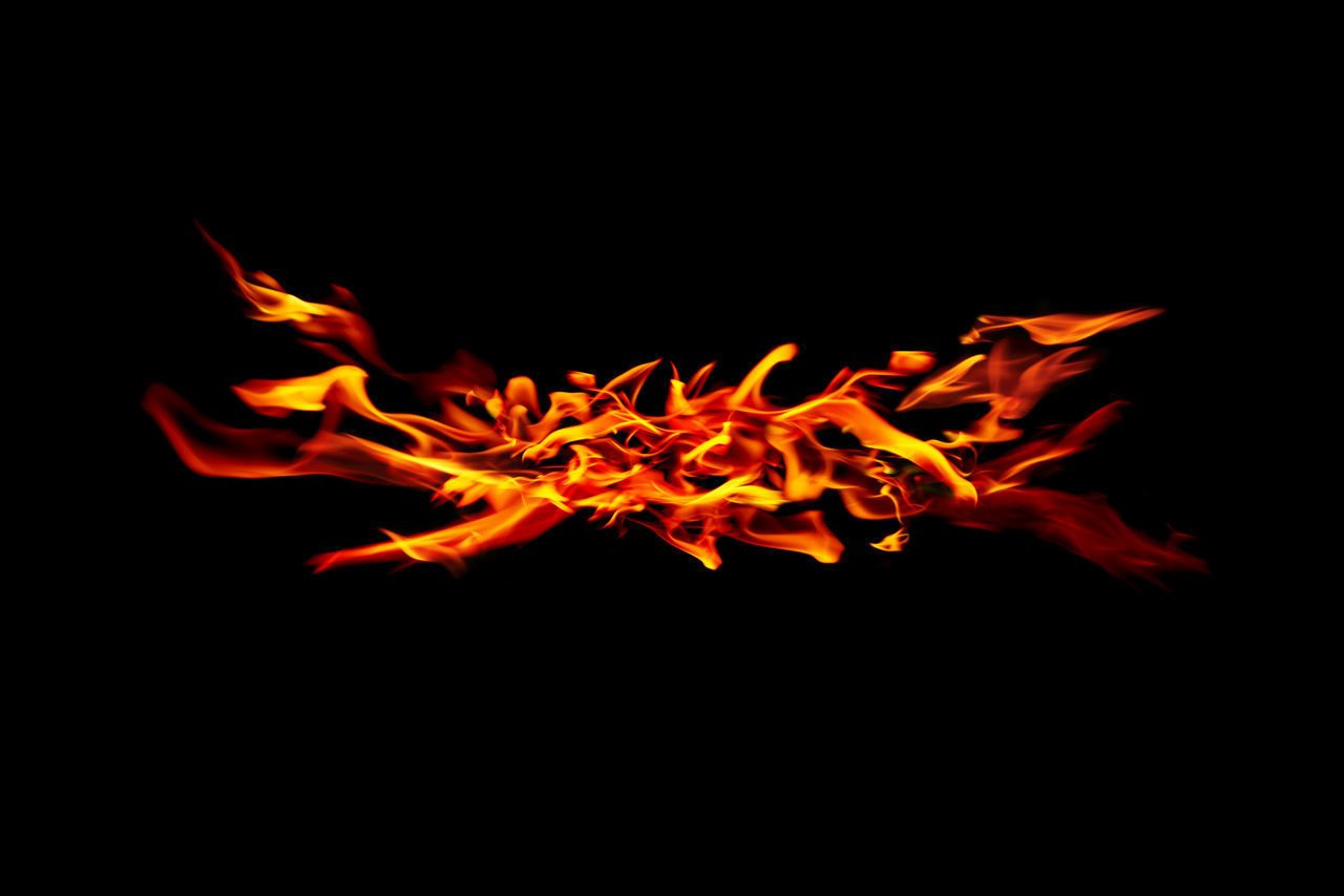 orange color, burning, fire, flame, fire - natural phenomenon, heat - temperature, night, copy space, nature, no people, motion, studio shot, close-up, glowing, black background, bonfire, long exposure, blurred motion, illuminated, indoors, dark, campfire