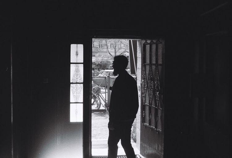 Rear view of a man in window