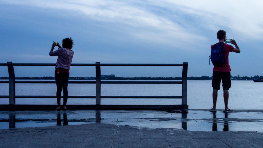 Photographers waiting for the sunrise at the Mekong, Phnom Penh Cambodia Silhouette Nature Photography Railing Rear View Sky Two People Water