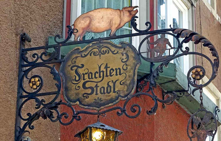 German beer house sign German Signs Lantern Wall Sign Animal Themes Architecture Building Exterior Built Structure Close-up Crafted Iron Day Dog German Beer Hand Painted Sign Iron Scroll Sign Metal No People Outdoors Pig Sign Text Wrought Iron