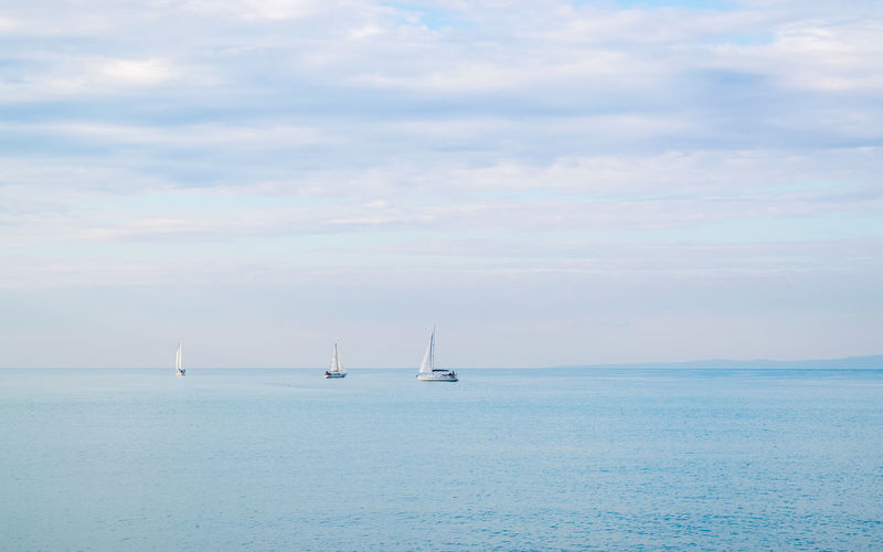 Sailboat in sea against sky