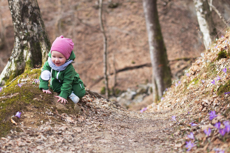 Cute baby girl in park during winter