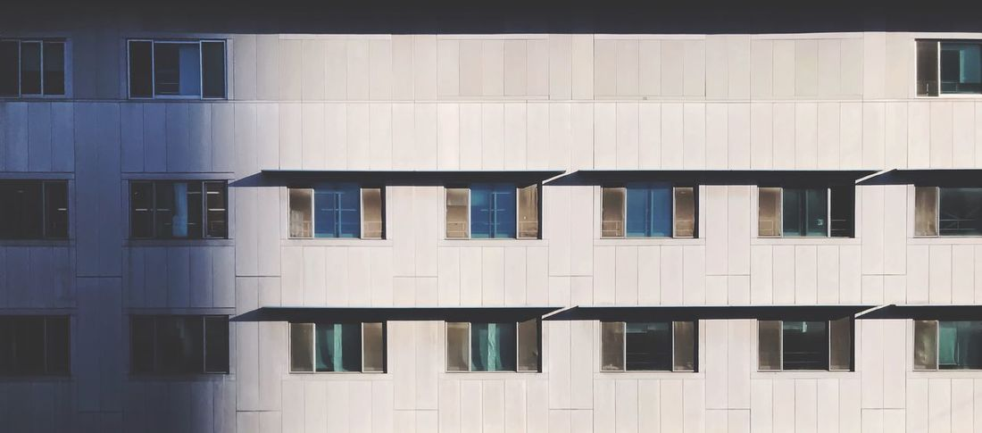 Built Structure Window Building Exterior Architecture Side By Side Building No People Wall - Building Feature Pattern Backgrounds Sunlight Residential District Outdoors Full Frame Repetition Day In A Row White Color Shadow