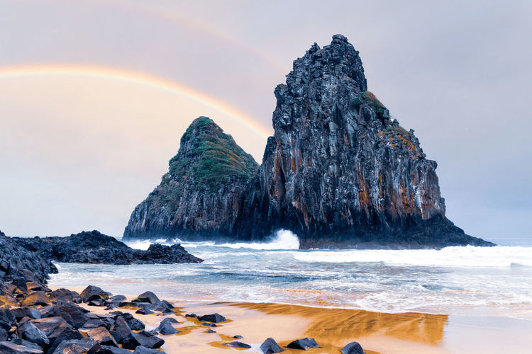Beach Beauty In Nature Horizon Over Water Idyllic Land Motion Nature No People Outdoors Rainbow Rock Rock - Object Rock Formation Scenics - Nature Sea Sky Solid Tranquil Scene Tranquility Water Wave