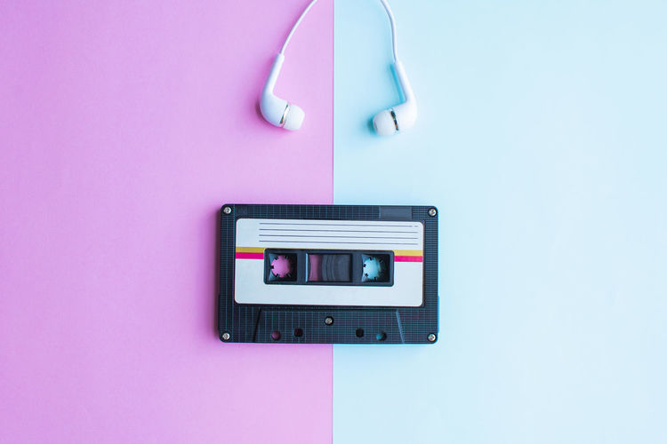 Tape Cassette Retro Old Vintage Technology Pink Color Indoors  Time Studio Shot Number Close-up Directly Above No People Communication Clock Wall - Building Feature Accuracy Single Object Connection Wireless Technology Copy Space Digital Display Colored Background