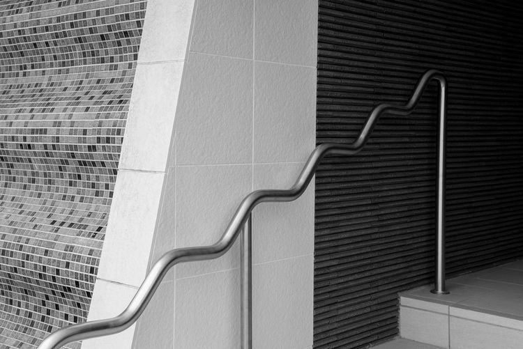 Black & White Architecture Building Building Exterior Built Structure City Close-up Day Flooring Light And Shadow Low Angle View Metal Modern No People Outdoors Pattern Railing Staircase Steps And Staircases Street Photography Streetphoto_bw Streetphotography Tile Wall - Building Feature
