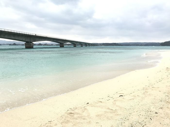 Architecture Beach Beauty In Nature Bridge - Man Made Structure Built Structure Cloud - Sky Connection Day Horizon Over Water Nature No People Outdoors Sand Scenics Sea Sky Travel Destinations Water