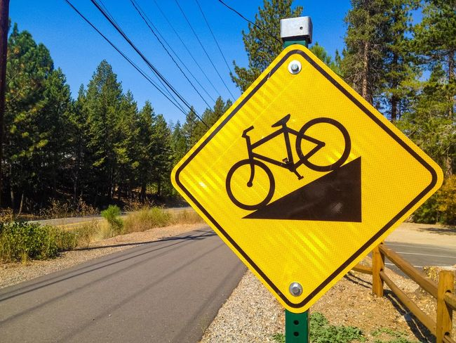 Bicycling sign in Truckee, on a fall afternoon. Blue Sky California On The Road Pine Trees Power Lines Road Sign Sign Signs Street Sign Symbols Transportation Truckee  Warning Sign