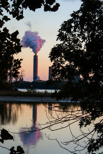 Beauty In Nature Built Structure Cottoncandy Factory Framing Mississippi River Nature PIASA Reflection River River View Riverbank Riverscape Riverside Sky Smoke Smokestack Summer Sunset Tall - High Tree Water First Eyeem Photo