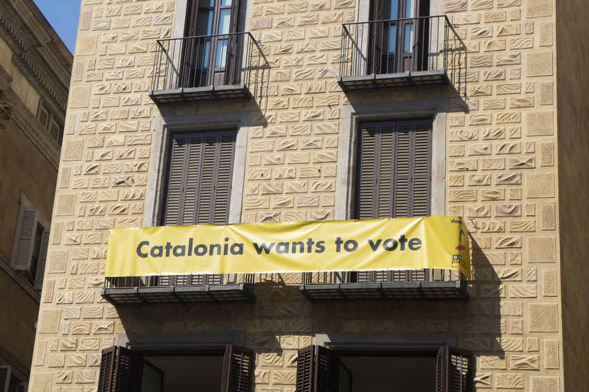"Barcelona, Spain - September 24, 2017 Banner claiming ""Catalonia wants to vote"" in La Merce festivities at Sant Jaume Square, Barcelona. Barcelona Catalonia Catalonia Is Not Spain Celebration Democracy Freedom La Merce Festival Protest SUPPORT Sant Jaume Teamwork Castellers Celebration Event Celebrations Cooperation Demonstration Festival Freedom Of Expression La Merce Performance Performing Arts Event Rally"