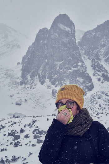 Close-up of person on snow covered mountain
