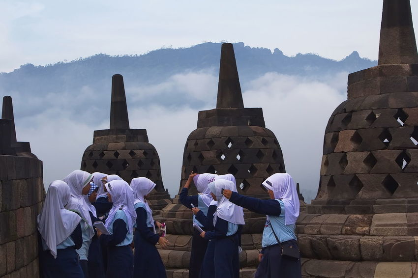 Studying In Borobudur temple. Architecture Borobudur Temple Day Girl Students Landscape Large Group Of People Outdoors People Pilgrimage Place Of Worship Religion Travel Destinations