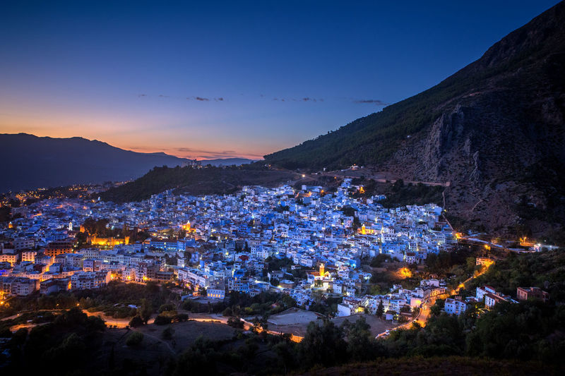 Chefchaouene at dusk Building Exterior Architecture Sky Mountain City TOWNSCAPE Landscape High Angle View Mountain Range No People Town Chefchaouen Chefchaouen Medina Blue City Blue Morocco Africa
