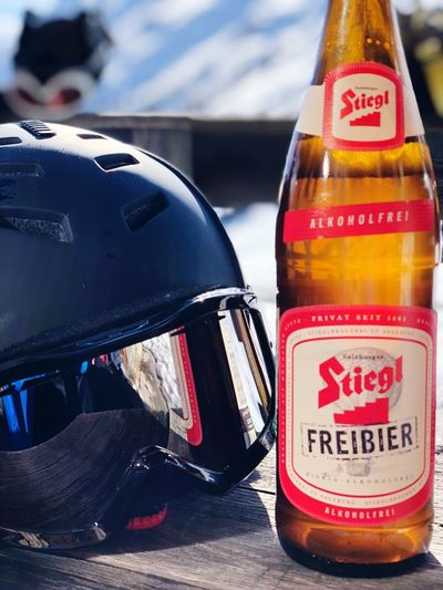 Time to enjoy a cold (alcohol free) Beer, After a long day of skiing Stiegl Iphonexphotography Skiing Sölden Beer Text Bottle Communication Close-up Focus On Foreground Drink