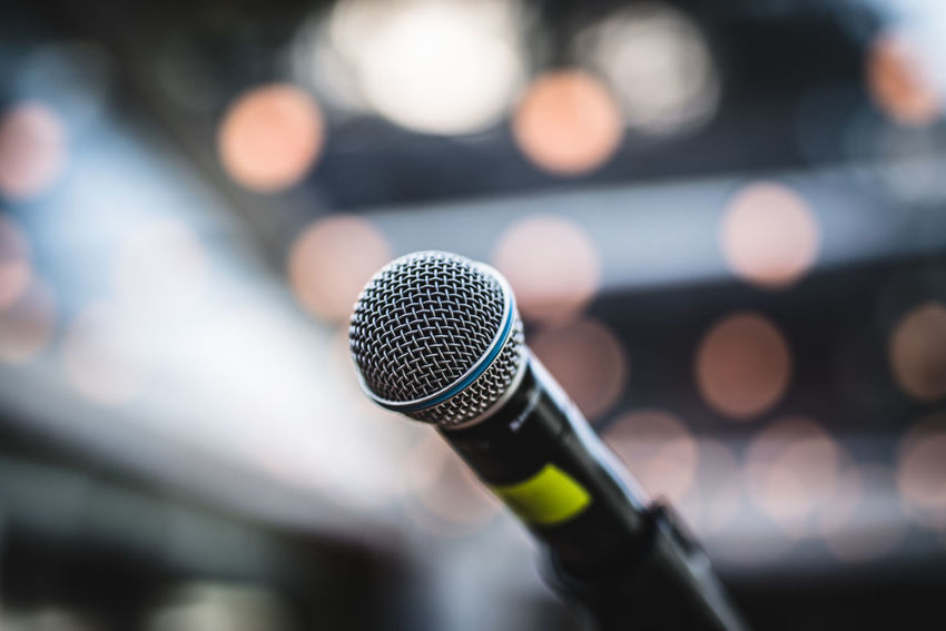 Arts Culture And Entertainment Audio Equipment Business Close-up Communication Conference - Event Equipment Focus On Foreground Indoors  Input Device Light - Natural Phenomenon Microphone Microphone Stand Music No People Performance Selective Focus Single Object Speech Stage Talking Technology