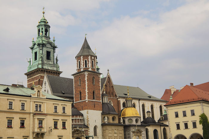 View of Wawel Castle Cathedral in Krakow, Poland Architecture Cathedral Church Historical Building Tourist Attraction  Wawel  Wawel Castle Wawel Royal Castle Architecture Building Exterior Built Structure City Clock Tower Day Eclectic Famous Place History Low Angle View No People Outdoors Place Of Worship Religion Sky Tower Travel Destinations