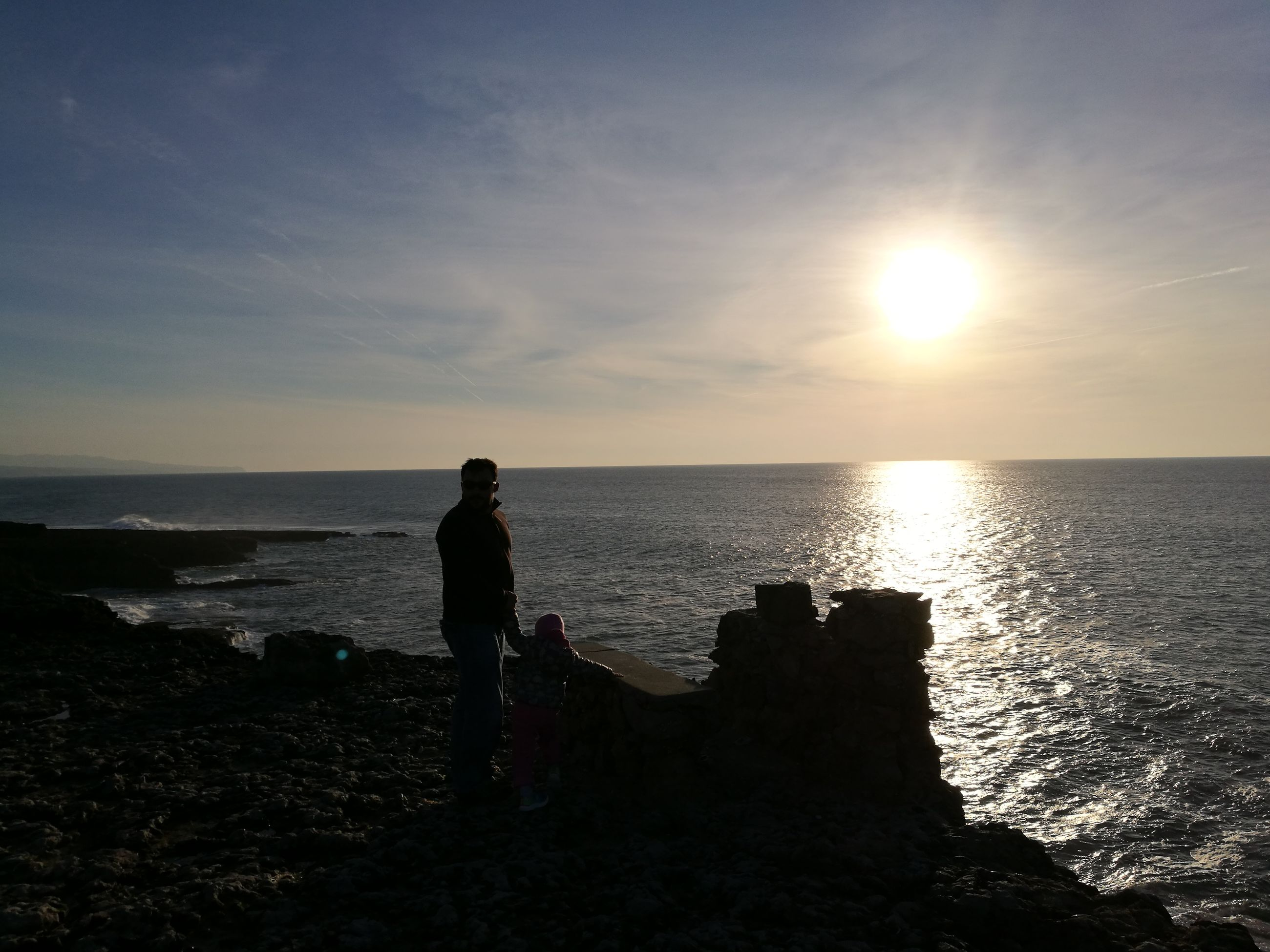 sea, horizon over water, silhouette, one person, sky, sunset, standing, water, tranquility, rear view, beach, full length, beauty in nature, one man only, only men, people, outdoors, scenics, adults only, adult, nature, day