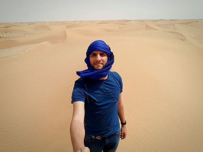 Portrait Of Young Man In Desert