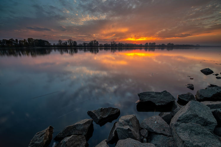 Water Sky Scenics - Nature Beauty In Nature Sunset Tranquility Tranquil Scene Reflection Solid Rock - Object Rock Cloud - Sky Lake Orange Color Idyllic Nature Non-urban Scene No People Outdoors Wisła Wisla Wisła River VistulaRiver Vistula River