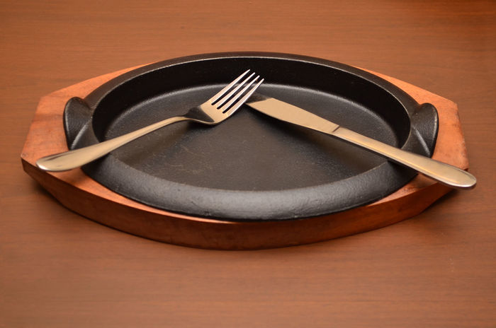 An empty dish Knife Light Poor  Wait Waiting Affordable Calories Clean Empty Fat Finish Food Fork Healthy Hotel Metal No People Plate Plates Restaurant Silverware  Skillet- Cooking Pan Steak Table Wood - Material