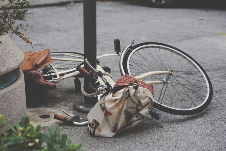 High angle view of fallen bicycle on road
