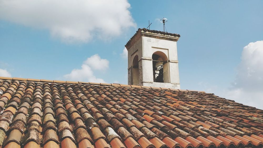 Time's up. EyeEm Selects Roof Roof Tile House Sky Architecture Building Exterior Cloud - Sky Tiled Roof  Bell Tower - Tower Rooftop Bell Tower Brick