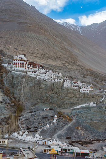 High angle view of buildings on mountain against sky