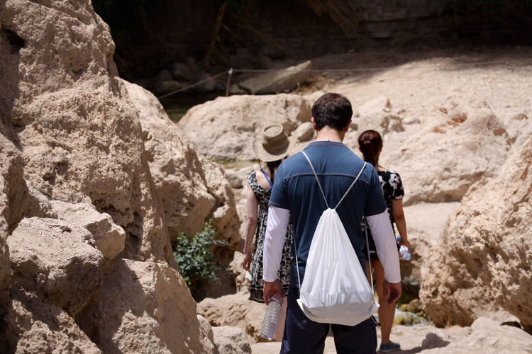 Hikers Backpacking Beauty In Nature Casual Clothing Cliff Desert Ein Gedi, Jericho, Palestine, Palestinian, Israel, Israeli, National Park, Eroded Full Length Geology Hikers Hot Leisure Activity Lifestyles Nature Physical Geography Rock Rock - Object Rock Formation Rocks Tourism Tourist Tranquility Vacations