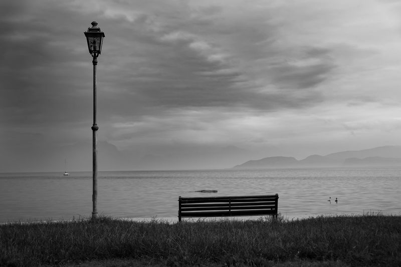 A dark one... Alone Bank Beach Beauty In Nature Black And White Cloud - Sky Dark Foggy Grass Horizon Over Water Lake Lost Nature Scenics Sea Shadow Sky Street Light Theme Thinkfull Tranquil Scene Tranquility View Wallpaper Water