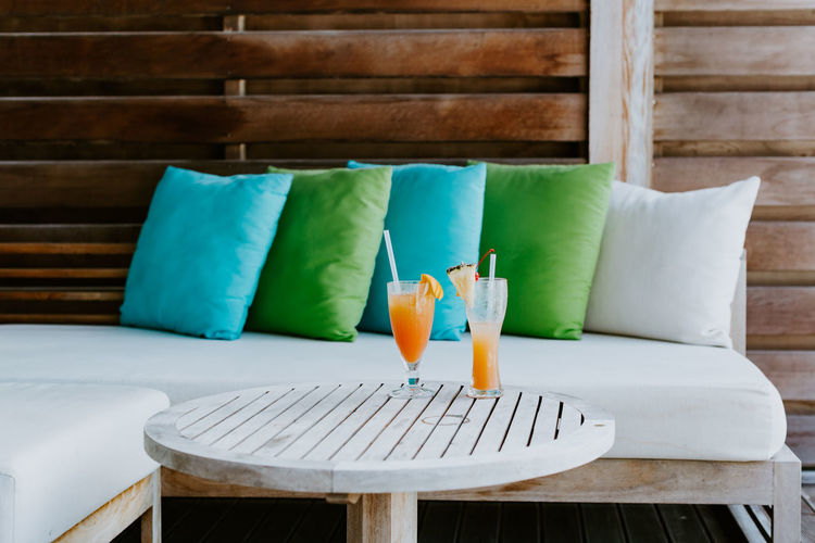tropical cocktails on resort hotel. No people Wood - Material Furniture Seat No People Arrangement Sofa Relaxation Chair Cocktail Alcohol Drinking Glass Drinks Exotic Tropical Hotel Resort Juice Pineapple