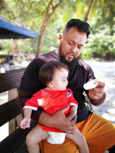 Pulau Redang, Terengganu, Malaysia. Real People Family Child Parent Childhood Males  Bonding Mid Adult Men Togetherness Father Family With One Child Love Adult Three Quarter Length Mid Adult Men Sitting Son Daughter Positive Emotion Innocence Care