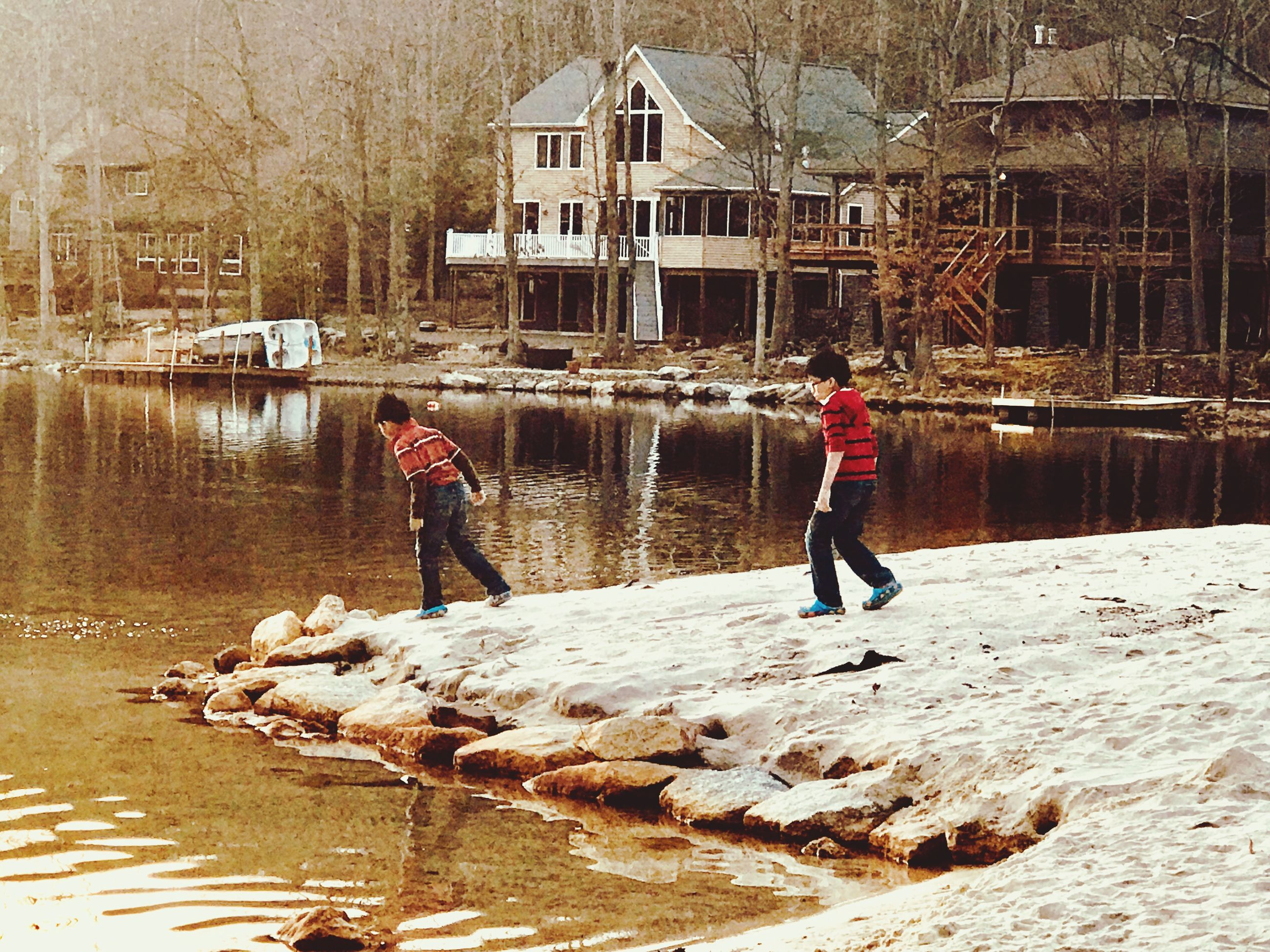 water, real people, built structure, nature, architecture, full length, lake, people, day, lifestyles, men, building exterior, reflection, child, childhood, winter, leisure activity, outdoors, warm clothing