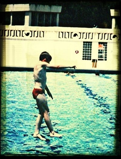 Me as a kid in france walking on water. No editing. Just a jump from a diving board and well timed camera click.