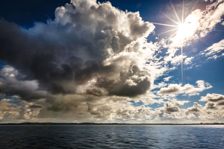 Multi Weather Dramatic Sky Storm Weather Weather Photography Beauty In Nature Cloud - Sky darkness and light Day Nature No People Outdoors Scenics Sea Sky Sun Sunbeam Sunlight Thunderstorm Tranquility Water