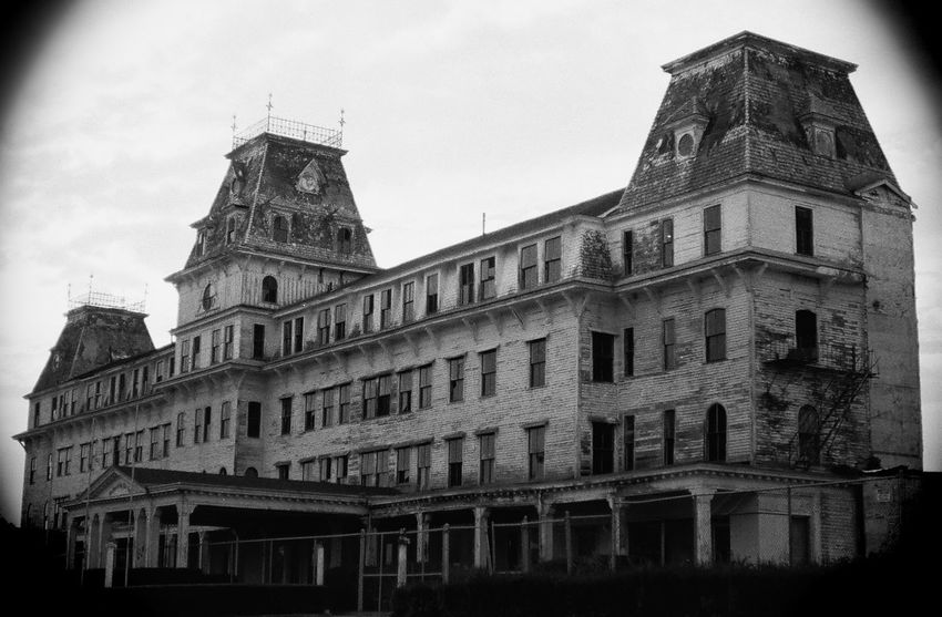 Blast from the past the old abandoned the victorian Wentworth By The Sea hotel, photographed in 1999 B&W film. This is when I was first started doing photography. The hotel finally was bought by the Marriott and given a restored to its grand glory. 1999 Abandoned Places Alone Decay Film Gothic Haunted Places Hauntingly Beautiful Victorian Abandoned Abandoned Buildings Architecture Blackandwhite Building Exterior Built Structure Decaying Goth Haunted History Hotel Low Angle View Ocean Sea Travel Destinations Wentworth
