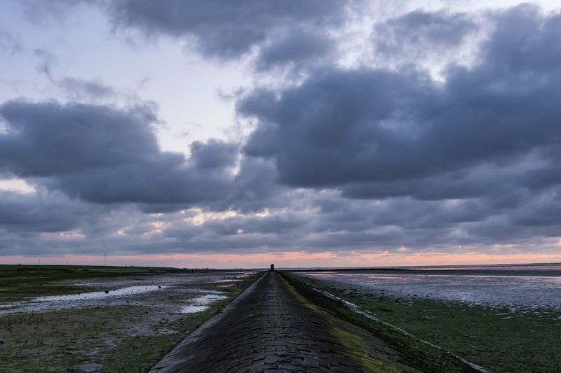 Neuharlingersiel, North Germany Cloud - Sky Sky Scenics Tranquil Scene Tranquility Nature Beauty In Nature The Way Forward Outdoors Water Stone Horizon Over Water Day Sea Sunset