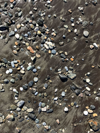 Beach stones at surf Abundance Backgrounds Beach Close-up Day Full Frame Nature Nature No People Outdoors Pebble Pebble Beach Sand Stones