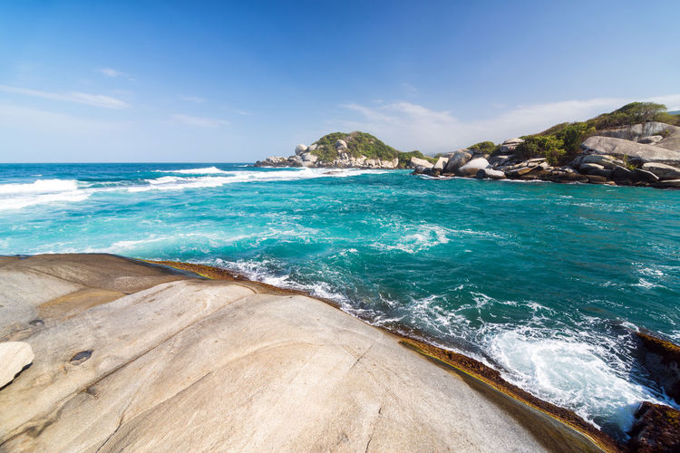 Rock Formations In Sea Against Sky At Tayrona National Park