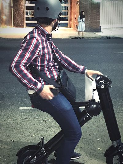 Electric bicycle Non Pollution Medium Electric Transport Electric Bike Electric Bicycle Transportation City One Person Street Bicycle Lifestyles Mode Of Transportation Building Exterior Men Land Vehicle Leisure Activity Day Full Length Casual Clothing Built Structure Adult Outdoors Real People Architecture Road