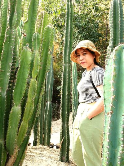 Portrait of girl standing by plants