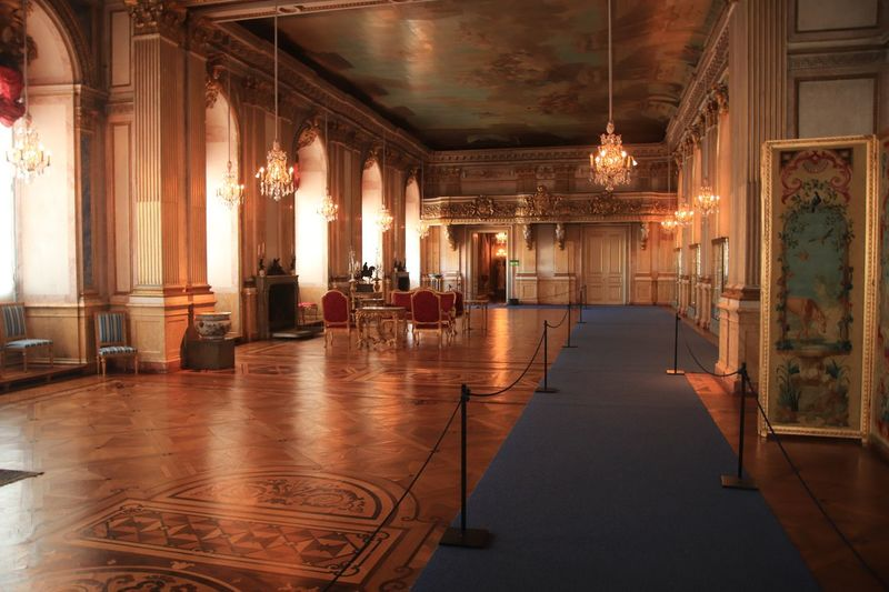 Royal Palace event hall. The Netherlands has a much beloved Royal Family. This is an event space in the Royal Palace. The Traveler - 2018 EyeEm Awards The Architect - 2018 EyeEm Awards Event Hall Royal Palace EyeEm Selects Architecture Wealth Illuminated Lighting Equipment Built Structure Indoors  Luxury Architectural Column Travel Destinations No People The Past Building Chandelier Chair Furniture