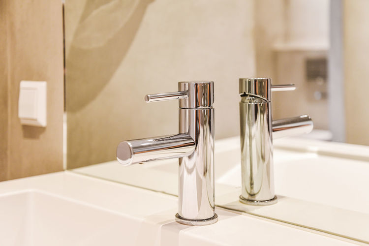 Close-up of faucet in bathroom