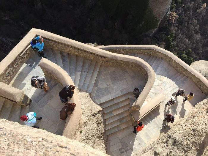 Directly above shot of people walking on steps during sunny day