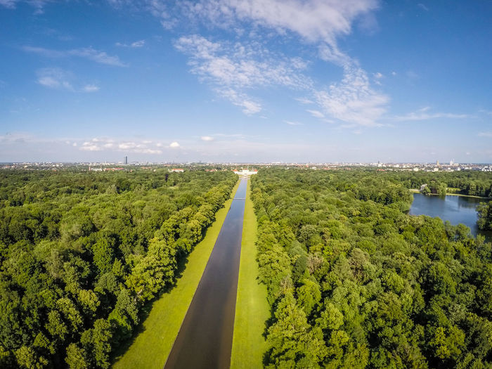 An aerial shot of the Nymphenburgerschloss in Munich, Germany. Sky Plant Cloud - Sky Nature Tree Green Color Landscape Day Beauty In Nature Tranquility Scenics - Nature Environment Tranquil Scene No People Growth Water Sunlight Road Horizon Outdoors Munich Aerial Shot Treesfromabove